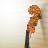 Violin neck on musical background Stock Photography