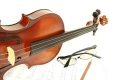Violin on note with glasses and pencil Stock Photo