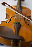 Violin on notes Stock Photos