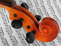 Violin on notes. Violin on music notes stock images