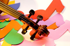 Violin and Notes. A violin scroll over colored eighth notes stock image