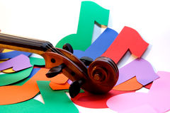 Violin and Notes. A violin scroll over colored eighth notes stock photo