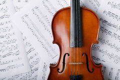 Violin on an notes background Royalty Free Stock Photography