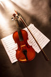 Violin and notes Stock Photos