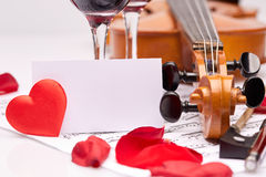 Violin, notes and red wine. Stock Photography