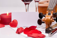 Violin, notes and red wine. Stock Image