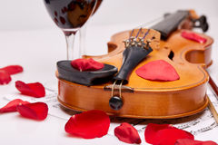 Violin, notes and red wine. Stock Photo
