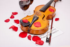 Violin, notes and red wine. Stock Photos