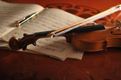 Violin and notes on the table Stock Image