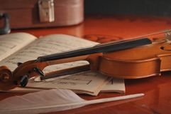 Violin and notes on the table Stock Images