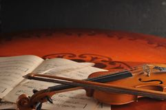 Violin and notes on the table Stock Photos