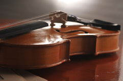 Violin and notes on the table Royalty Free Stock Photo
