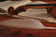 Violin and notes on the table Stock Photo