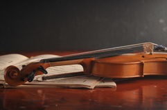 Violin and notes on the table Royalty Free Stock Image