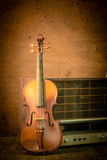 Violin and old radio in vintage style Stock Photos