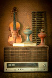 Violin and old radio in vintage style Stock Photography