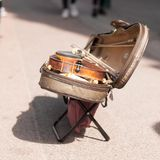 Violin in an open case on a city street Stock Photography
