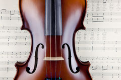 Violin on open old sheet music book Stock Photography