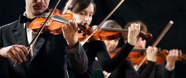 Violin orchestra performing Royalty Free Stock Images