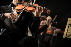 Violin orchestra performing stock photography