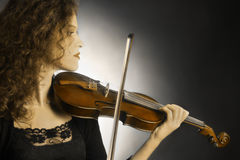Violin orchestra player Stock Photo