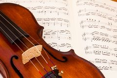 Violin over a music score sheet royalty free stock image
