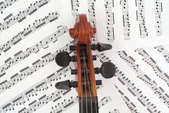 Violin Peg Box with Music. Violin peg box and the beautiful scroll royalty free stock images