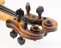 Violin peg boxes. Close up of violin peg boxes royalty free stock image