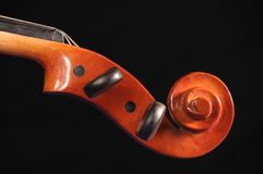 Violin pegbox. On black background Royalty Free Stock Images