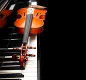 Violin on the piano. On a black background royalty free stock photo