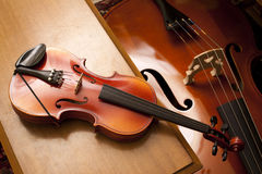 Violin on a piano bench Stock Photo