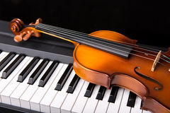 Violin on the piano Stock Photos