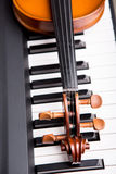 Violin on the piano Stock Photo