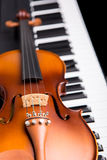 Violin on the piano Stock Photography