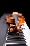 Violin on the piano Royalty Free Stock Photo
