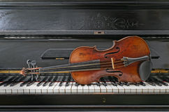 Violin and piano. Close up Antique Violin and piano instruments Royalty Free Stock Photography