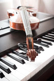Violin on piano. Fade color tone. Art and music background. With dark vignette Royalty Free Stock Photography
