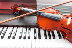 Violin and piano keyboard Stock Photo