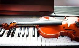 Violin and piano keyboard Stock Photo