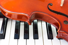 Violin and piano keyboard Stock Images