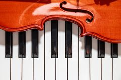 Violin on the piano keys closeup look stock images