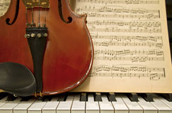 Violin Piano Keys and Music Sheets stock images