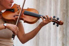 Violin player. A violinist during a street performance Stock Photos