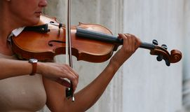 Violin player. A violinist during a street performance stock photography