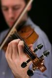 Violin player. On black Stock Photos