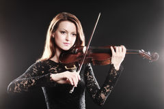 Musician violinist playing violin Stock Images