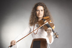 Violin player classical violinist. Violin player violinist playing classical music Stock Photos