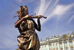 Violin player. Hermitage museum background. Stock Photography