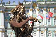 Violin player. Hermitage museum background. Royalty Free Stock Photography
