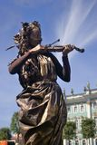 Violin player. Hermitage museum background. Royalty Free Stock Photos